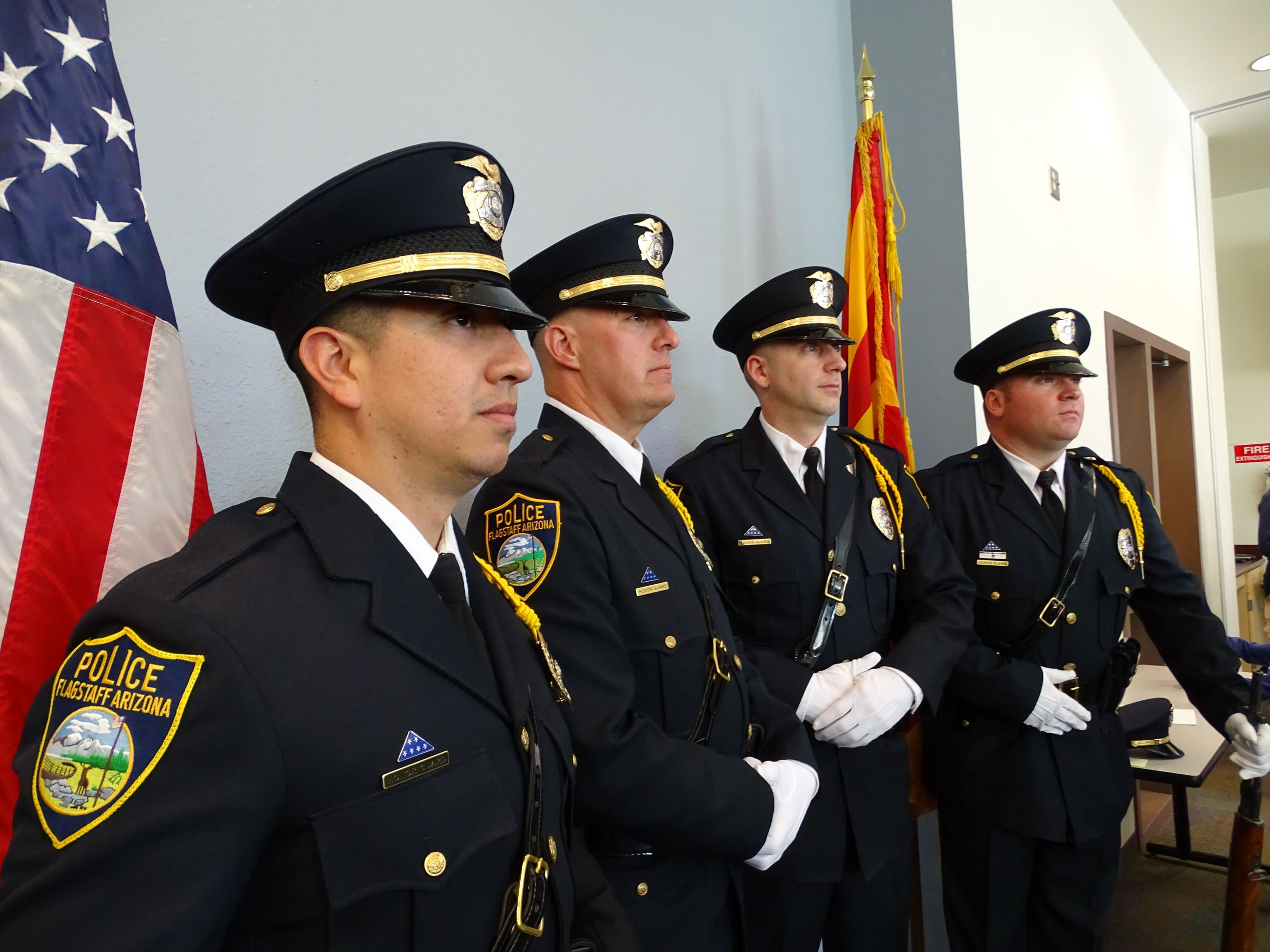 4 Police Officers in Full Uniform